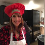 Michelle cooking with red chefs hat