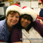 Two Women Wearing Santa Hats